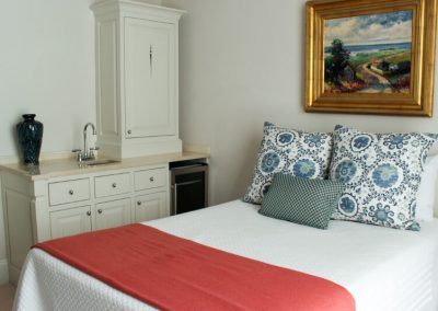 guest-room-bed-with-sideboard-detail-800x533