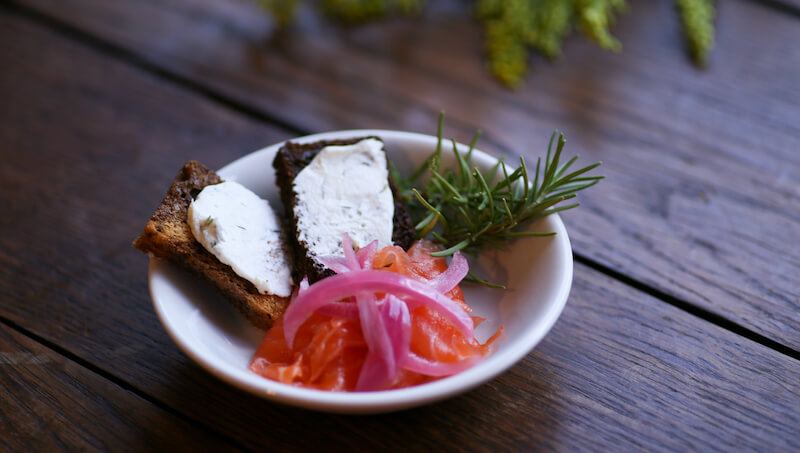 House Made Gravlax with dill goat cheese, pickled onion, rye toast