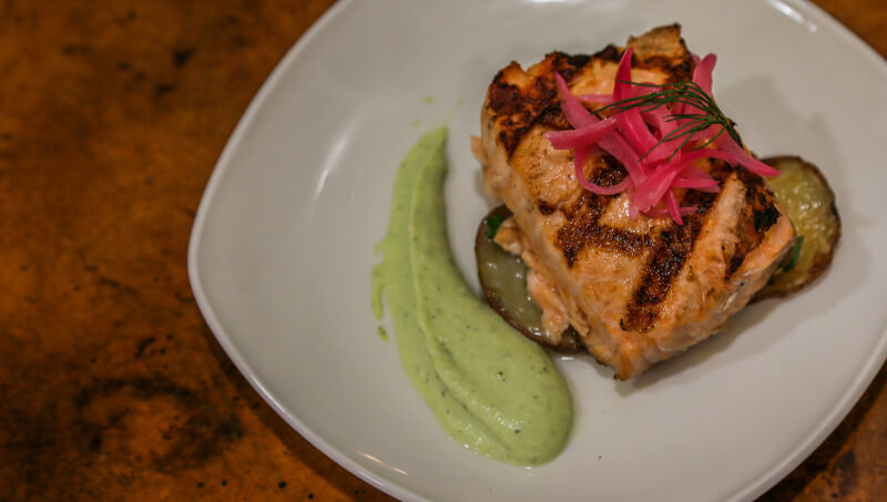 Grilled Scottish Salmon with garlic roasted potatoes, pickled onions, lemon dill aioli