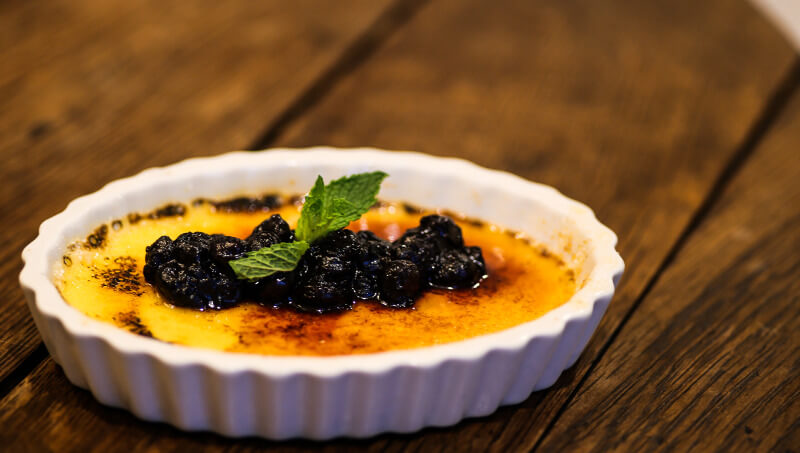 Lemon Crème Brulee with blueberry compote