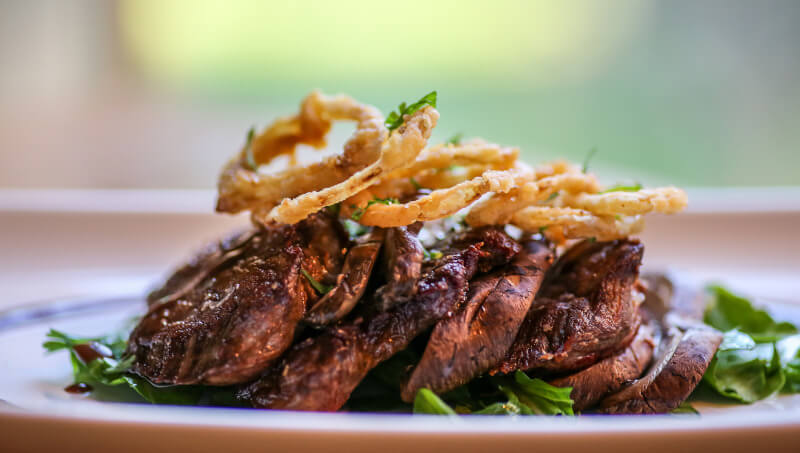 Seared Beef Medallions with marinated portabellos, arugula, red wine demi, shallot rings